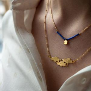 Collier 3 poissons finition or porté avec un collier pampille - Les Naturalistes bijoux